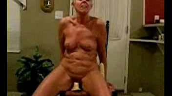 Genuinely nude granny riding a dildo